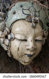 Close up colorful ceramic face statue