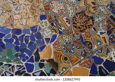 a close up colorful ceramic pattern mosaic tile by Antoni Gaudi in magnificent park Guell on the hills of Barcelona, Catalonia, Spain