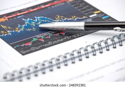 Close up of colorful chart or graph with economic information and business news for financial background
