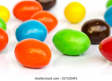 Close up of colorful chocolate coated candy .