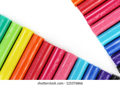 Close up colorful clay sticks isolated on white background.