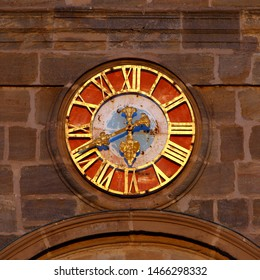 Close up of colorful clock at the tower of Hugenottenkirche (huguenot church) in Erlangen, Franconia, Bavaria, Germany.
