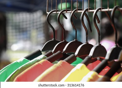 Close up colorful clothes hanging, Colorful t-shirt on hangers or fashion clothing on hangers.