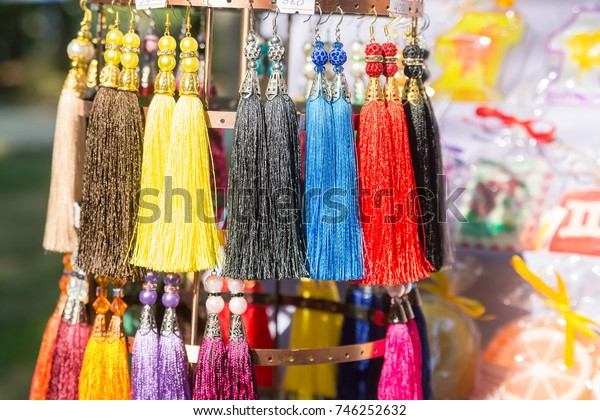 Close up colorful ethnic thread earrings for sale