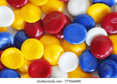 close up of colorful industrial plastic pellets background