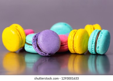 Close up of colorful macarons dessert on purple background .