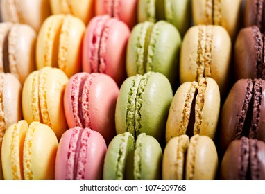close up of colorful macaroons as background