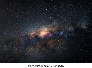 Close up of Colorful milky way galaxy with space dust and stars in the space, long exposure with grain.