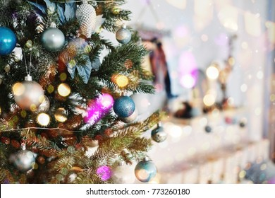 Close up of colorful ornaments on Christmas tree. Happy New Year and Christmas. Bokeh light soft effect.