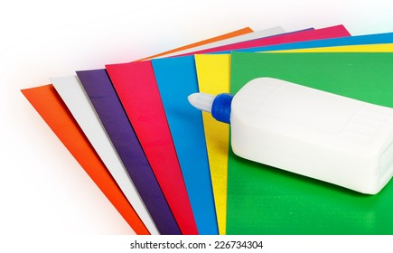 Close up colorful paper with glue isolated on white bacground