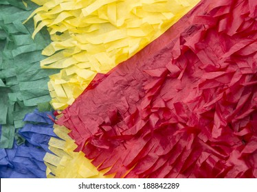 close up of a colorful paper pinata