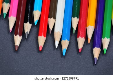Close up of colorful pencils on black background