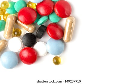 Close up of colorful pills isolated on white.