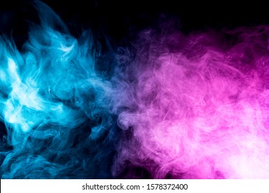 close up of colorful pink and blue steam smoke in mystical and fabulous forms on black background.Mocap for art