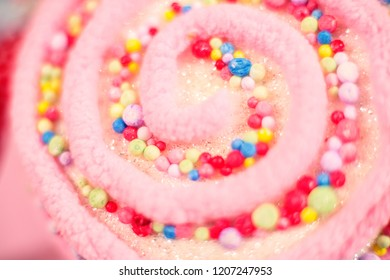Close up of colorful pink plush toy swirl lollipop