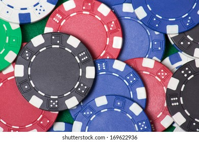 close up of colorful poker chips on the table