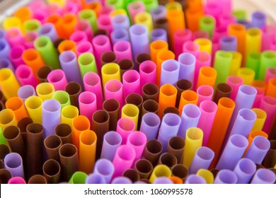 Close up to colorful straws background