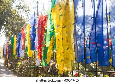 Close up colorful Tibetan flags along side next to the entrance gate of Guru Rinpoche Temple at Namchi. Sikkim, India.
