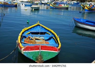 close up colorful traditional wooden fishing boats in harbor of Mediterranean island Malta