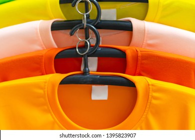Close up of Colorful t-shirts on hangers