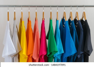 Close up of Colorful t-shirts on hangers, apparel cloth background