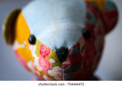 Close up of a colorful vintage teddy bear