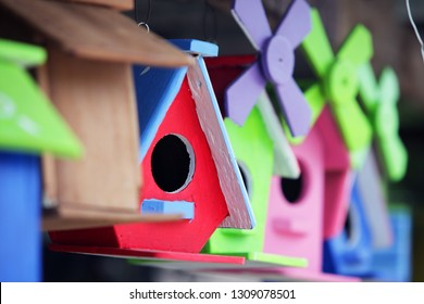 close up of colorful wooden bird house background