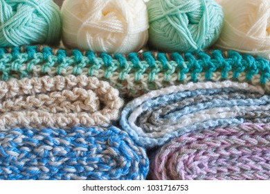 Close up colorful yarn texture background, beige, brown, green, turquoise, blue, violet, pink strains. Shallow depth of focus. Knitting and crochet, craft work concept. Color combination for styling.