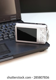 A close up of a compact digital camera