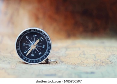 close up compass on paper map, travel and lifestyle, manage to success business technology concept, vintage tone
