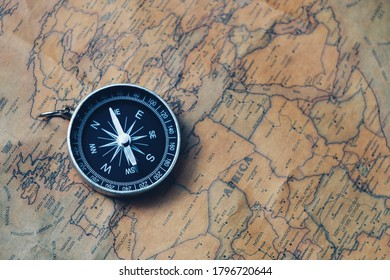 close up compass on paper map, travel bubble, relaxation and lifestyle concept