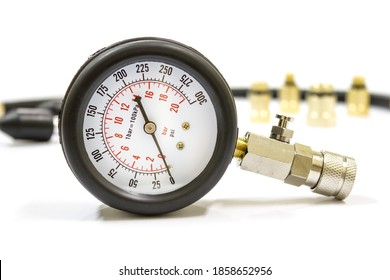 Close up of compression meter use for measure car cylinder compression on white background, Isolated.