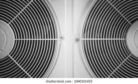 Close up compressor air conditioner.Compressor's protection grid.