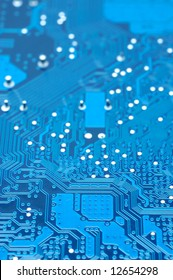 Close up of computer circuit board in blue