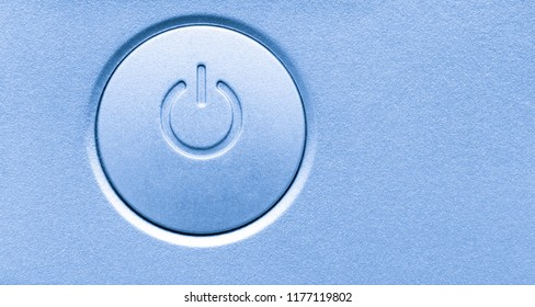Close up of computer electronic device on/off power button. Horizontal background image with empty blank copy space. Modern technology symbol icon.