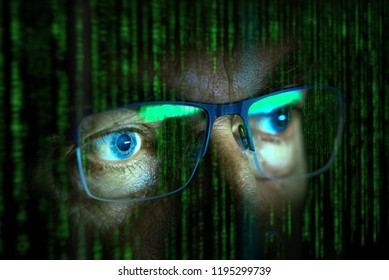 close up of computer hacker eyes looking at screen with data in the foreground