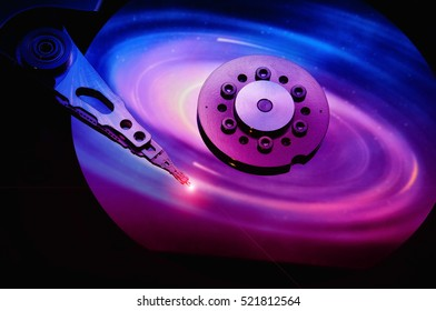 close up of computer hard drives disc with space color effects