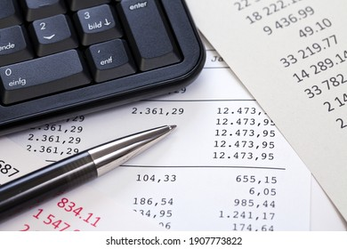 close up of computer keyboard and columns of figures for accounting and calculation of budget management