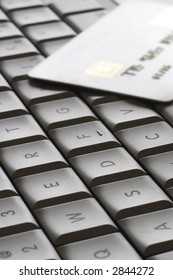 close up of computer keyboard with credit card ready to shop online