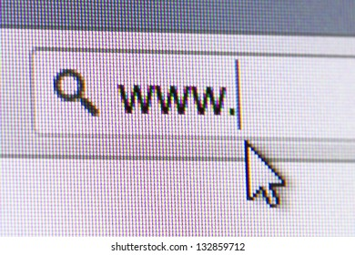 Close up of computer screen internet browser address bar, www text and arrow mouse cursor