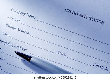 Close up Conceptual Blank Credit Application Form and Pen on Top of the Table.