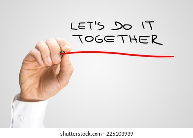 Close up Conceptual Handwritten Red Underline on Lets Do It Together Texts Isolated on Gray Background.