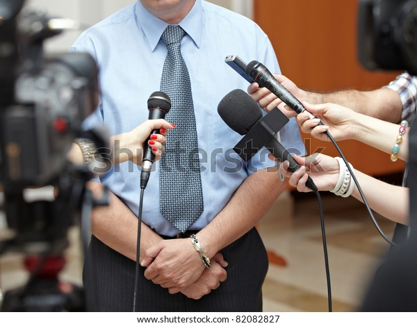 close up of conference meeting microphones and businessman