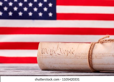 Close up Constitution of US on USA flag background. Declaration of Independence of the United States of America with american flag in the background.