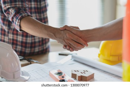 Close up construction worker or engineer shaking hands after finish an agreement.