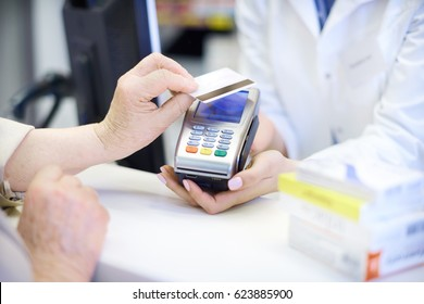 Close up of contact-less payment at pharmacy