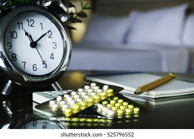 Close up of contraceptive pills with bed room background