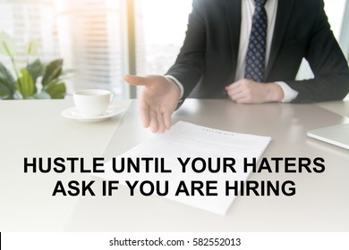 """Close up of a contract proposing to sign, full and accurate details, individual who owns the business sign personally. Photo with motivational text """"Hustle until your haters ask if you are hiring"""""""