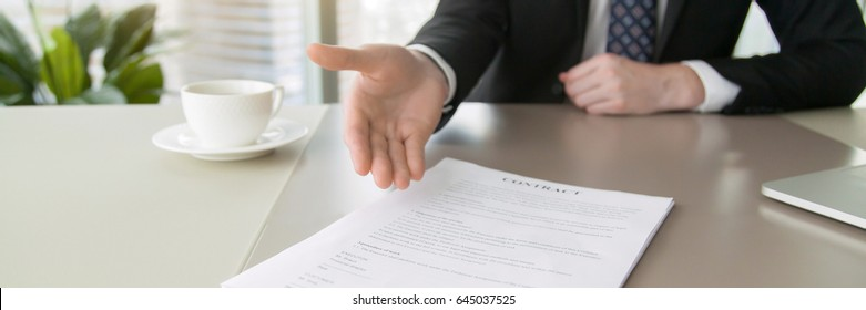 Close up of a contract proposing to sign, full and accurate details, individual who owns the business sign personally. Horizontal photo banner for website header design with copy space for text