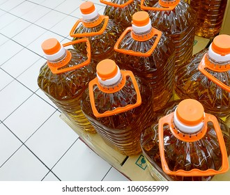 Close up of cooking oil bottles at supermarket, selective focus.